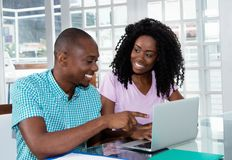Beautiful african american couple at computer Royalty Free Stock Photo