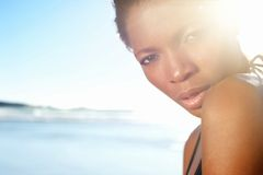 Beautiful african american female fashion model at the beach. Close up portrait of a beautiful african american female fashion model at the beach Royalty Free Stock Image