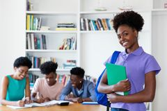 Beautiful african american female student at university stock photo