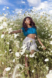 Beautiful African American girl enjoys summer day. Stock Photos