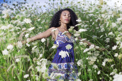 Beautiful African American girl enjoys summer day. Young beautiful African American girl enjoys summer day Royalty Free Stock Images