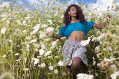 Beautiful African American girl enjoys summer day. Young beautiful African American girl enjoys summer day Royalty Free Stock Photos
