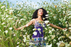 Beautiful African American girl enjoys summer day. Young beautiful African American girl enjoys summer day Royalty Free Stock Image