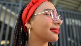 Beautiful african american girl in stylish sunglasses looking forward, make-up stock video