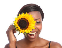 Beautiful african american girl and sunflower Royalty Free Stock Images
