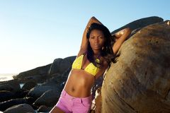 Beautiful african american model posing in bikini and shorts. Portrait of a beautiful african american model posing in bikini and shorts Royalty Free Stock Photography