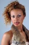 Beautiful African American model at the Studio. Beautiful African American model posing wearing fashionable dresses Royalty Free Stock Image