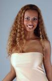 Beautiful African American model at the Studio. Beautiful African American model posing wearing fashionable dresses Stock Photos