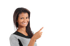 Beautiful african american model woman pointing and presenting beside Stock Photography