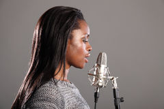 Beautiful african american singer recording studio Stock Images