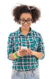 Beautiful african american teenage girl with mobile phone isolat Stock Image