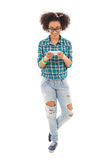 Beautiful african american teenage girl with phone isolated Royalty Free Stock Photos