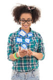 Beautiful african american teenage girl sending sms messages wit Stock Photos