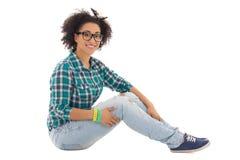 Beautiful african american teenage girl sitting Stock Photography
