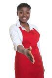 Beautiful african american waitress reaching hand for handshake Royalty Free Stock Photo