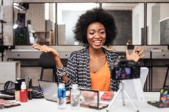 Beautiful african american woman with bright lipstick laughing happily stock photography
