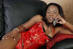 Beautiful African American woman on cell phone Royalty Free Stock Photos