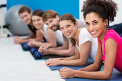 Beautiful African American woman in gym class. Beautiful African American women in gym class with a diverse group of her youn stock images
