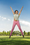 Beautiful African American woman jumping Royalty Free Stock Photography