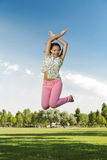 Beautiful African American woman jumping Royalty Free Stock Photos