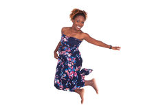 Beautiful African American woman jumping Stock Photo