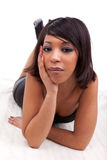 Beautiful African American woman lied on the floor Stock Image