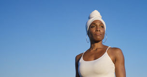 Beautiful african american woman looking into the sunlight ahead of her Stock Photography