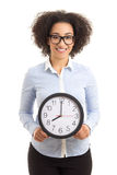 Beautiful african american woman with office clock isolated on w Stock Image
