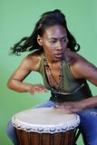 Beautiful African-American woman playing drums stock photos