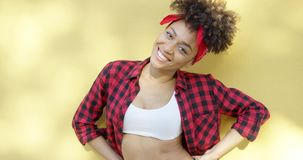 Beautiful african american woman posing. Against concrete wall. She wearing bandanna on her head and smiling to the camera stock video footage