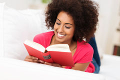 Beautiful African American woman reading Stock Photo
