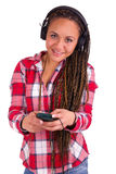 Beautiful African American woman sending a sms on cell phone Stock Image