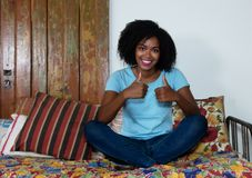 Beautiful african american woman showing both thumbs up Stock Photos