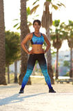 Beautiful african american woman standing outside in sportswear Royalty Free Stock Images