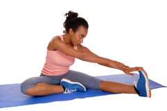 Beautiful african american woman stretching. Royalty Free Stock Image