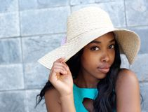 Beautiful african american woman with sun hat. Close up portrait of a beautiful african american woman with sun hat Stock Photo