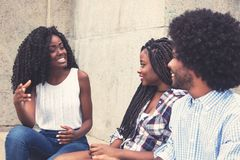 Beautiful african american woman talking with couple from Africa Royalty Free Stock Image