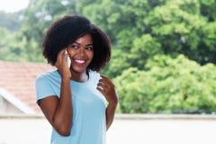 Beautiful african american woman talking at phone Stock Photo