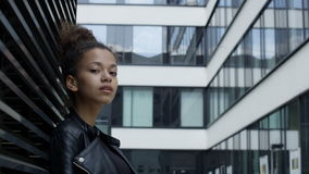 Beautiful african american woman in urban background.