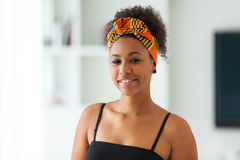 Beautiful African American woman wearing an african head scarf - Royalty Free Stock Images
