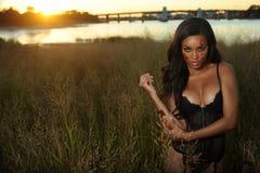 Beautiful African-american woman wearing black lingerie Stock Photo