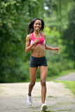 Beautiful African American woman works out Stock Image