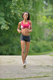 Beautiful African American woman works out Stock Photos