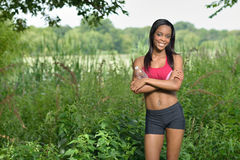 Beautiful African American woman works out Royalty Free Stock Photo