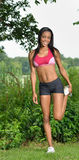 Beautiful African American woman works out Royalty Free Stock Image
