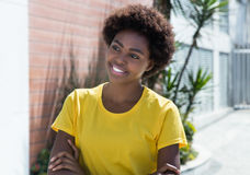 Beautiful african american woman in a yellow shirt Royalty Free Stock Images