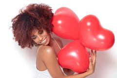 African american girl with heart shaped baloons. Royalty Free Stock Photos