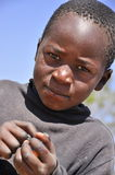 Beautiful african boy holding candies stock photography