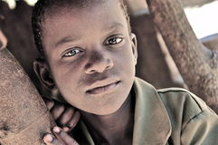 Beautiful african boy in the village royalty free stock image
