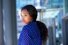 Beautiful african business woman standing outside Stock Images